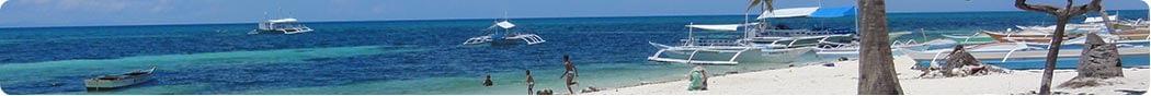 Locals enjoy the beauty of Malapascuas White Beach