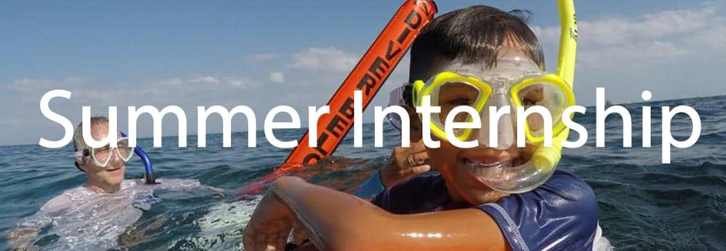 Taking children from the local community snorkelling to teach them about marine conservation