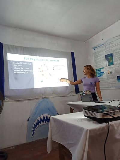 Our Lead Science Officer giving the presentation about the threat COTs pose to the marine environment